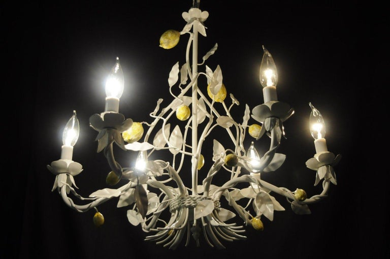 Vintage white and yellow lemon chandelier, Italian Hollywood Regency. Item features scrolling white painted metal frame, yellow lemon accents, leafy bobeche, six scrolling arms, and six lights, circa mid-20th century, Italy. Measurements: 21