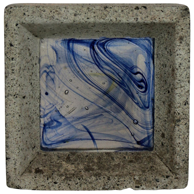 A whitefriars glass brick in concrete. Hand colored.