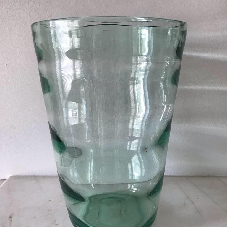 A lovely example of a sea green optical whitefriars vase. Probably designed by either James Hogan or William Wilson. These type of vases stopped being produced by 1957. Heavy handblown with a clever optical effect.