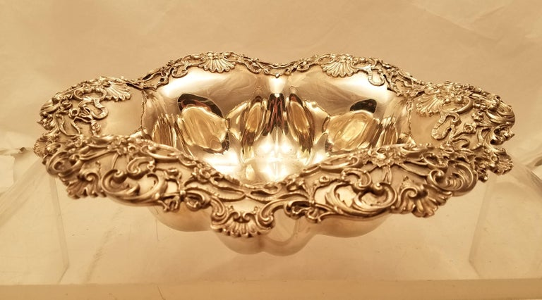 Sterling silver centerpiece / fruit bowl by Whiting, ornate in Victorian style. Measuring 12 inches in diameter and 3.3 inches in height. Bearing hallmarks as shown. Weighing 34.2 troy ounces.  Originally in Massachusetts, Whiting Manufacturing