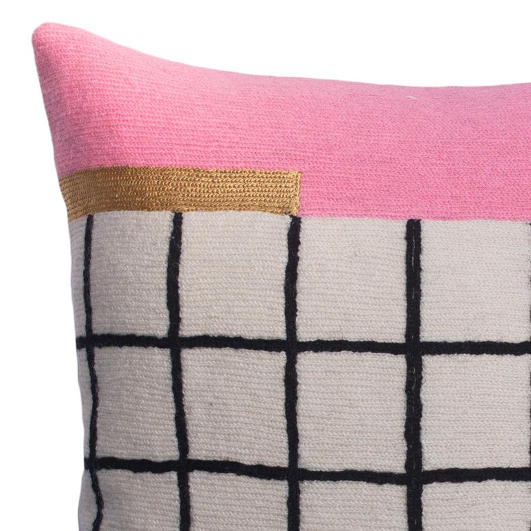 This geometric throw pillow has been ethically hand embroidered by artisans in Kashmir, India, using a traditional embroidery technique which is native to this region.  The purchase of this handcrafted pillow helps to support the artisans and
