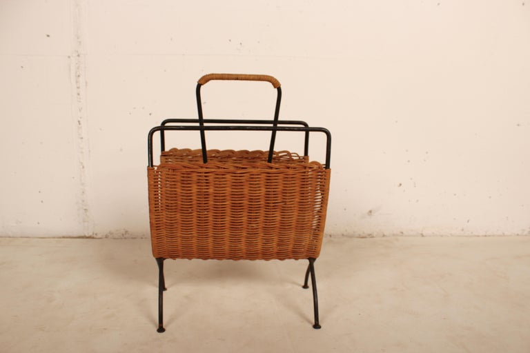 Wicker and black metal magazine holder by Raoul Guys, France, 1950.