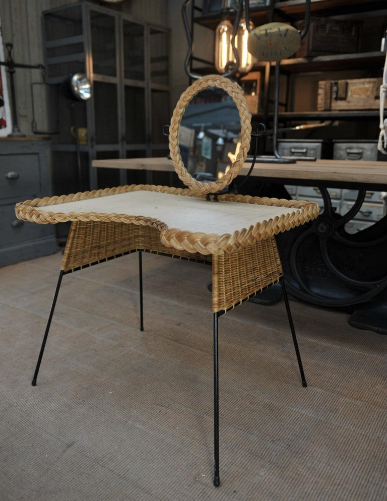French wicker and iron dressing table with swiveling mirror and his chair with leather straps circa 1960s  Height top 65 cm chair W 43 x D 42 x H 62 cm Height seat 40 cm, all in excellent condition.