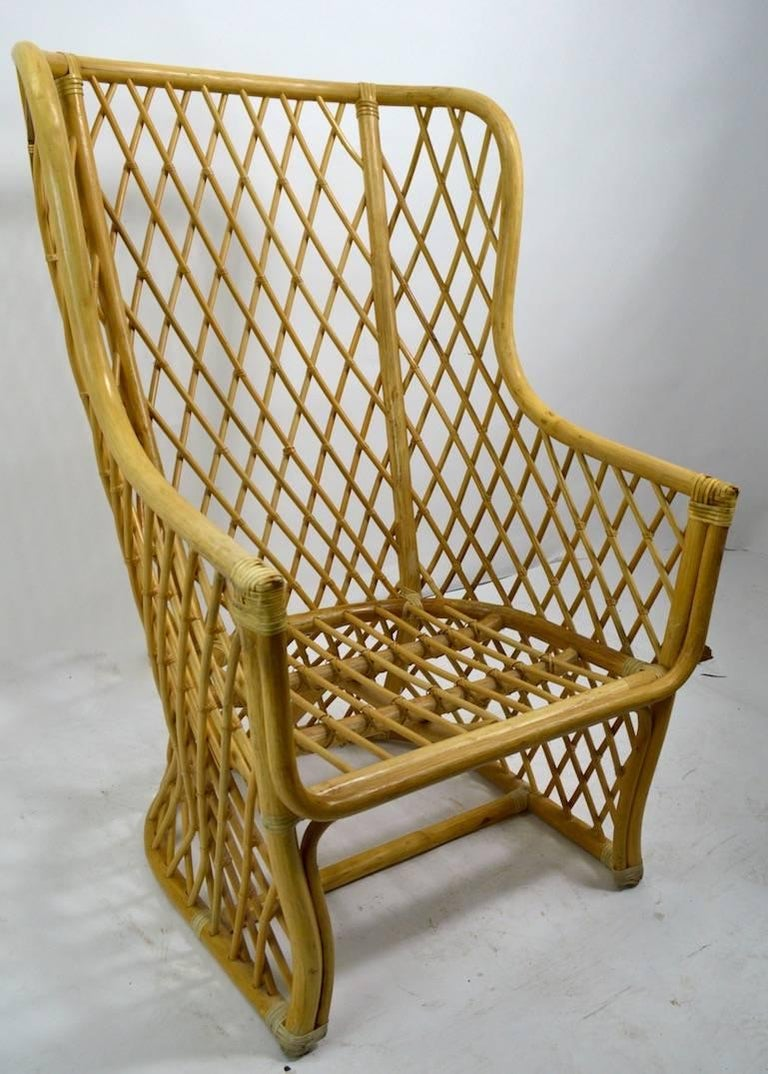 Modernist interpretation of the classic Bar Harbor wicker chair, circa 1970s-1980s possibly Italian made. This example is in very good, original condition, showing some wear to the wrapping at the hand rest, as shown. Upholstery usable but shows