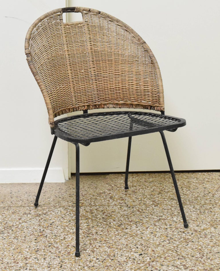 Tub chair model E2608 in Italian wicker by Tempestini for Salterini, circa 1952. Many other Salterini and Woodard pieces also available-- please inquire for details.