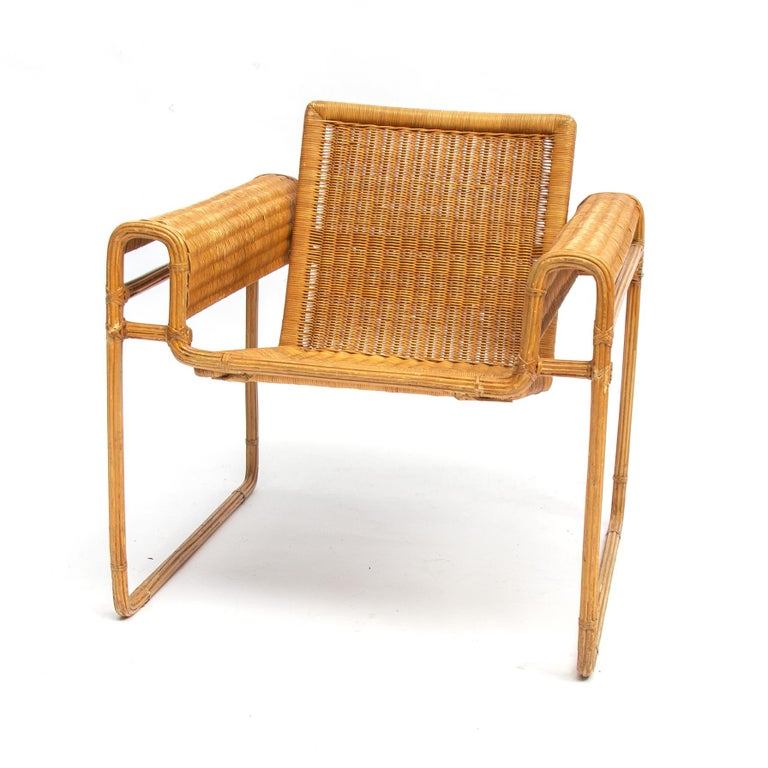 Rare and absolute unique translation of the original Wassily chair by Marcel Breuer. The metal frame owns covered with strips if lacquered bamboo, seating and beck are handmade wicker.  The Wassily chair, inspired by the frame of a bicycle and