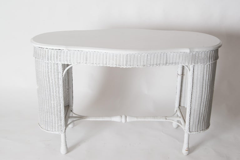 Vintage wicker reed/rattan table or writing desk with a wicker chair. Bothe pieces are early 19th century and freshly painted light grey. Excellent vintage condition.