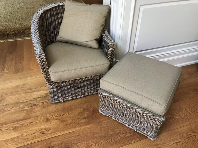 Vintage wicker lounging armchair and ottoman with cushions. Wonderful for porch, patio or garden room. See detail photo for matching sofa sold separately. Armchair measures 34 x 33 x 30 inches. Rattan, stick wicker.