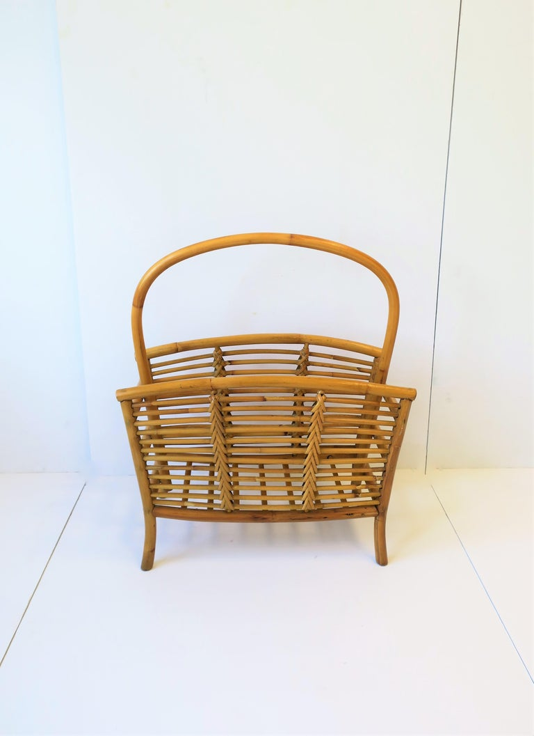 A vintage wicker, rattan, and bamboo magazine and book rack holder, circa late 20th century.   Piece measures:  22.75