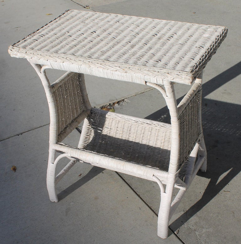 This small wicker side table is such a sweet size. It is in very good condition and has the original white painted surface.