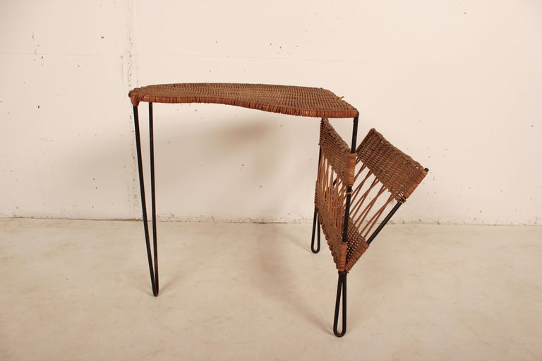 Wicker and black metal side table with magazine holder by Raoul Guys, France, 1950.
