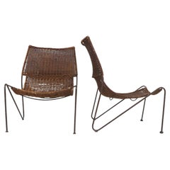 Wicker & Wrought Pair of Iron Lounge Chairs in the Manner of Frederick Weinberg