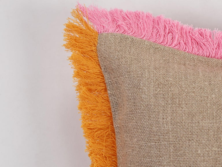 The pink and orange fringe border is entirely embroidered by hand on high quality natural linen. A cushion like this, can transform instantly a space.