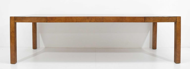 Beautiful burl wood dining table by Widdicomb/John Stuart. Table extends on each edge to drop in two 20