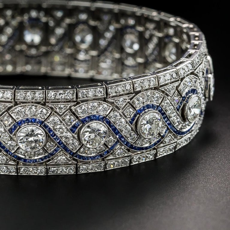 Round Cut Wide Art Deco Platinum Diamond and Calibre Sapphire Bracelet For Sale