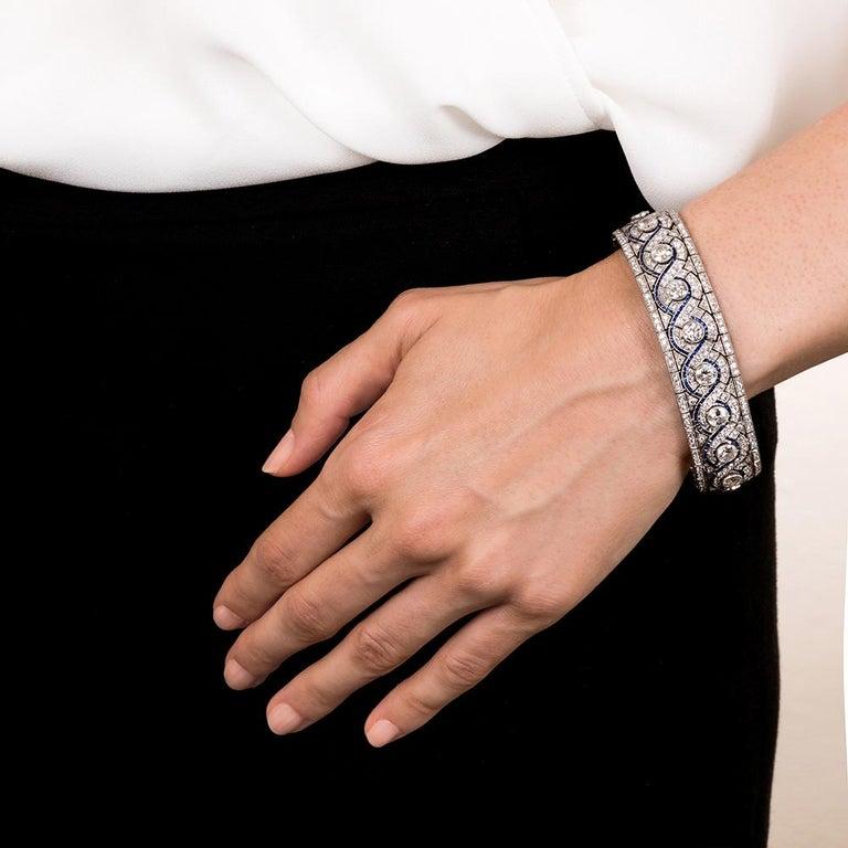 Wide Art Deco Platinum Diamond and Calibre Sapphire Bracelet In Excellent Condition For Sale In San Francisco, CA