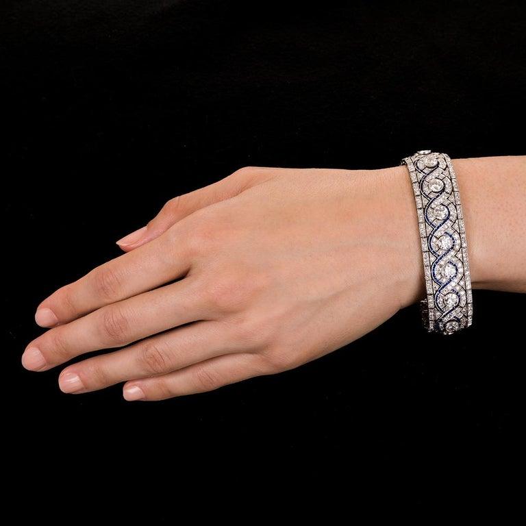 Women's or Men's Wide Art Deco Platinum Diamond and Calibre Sapphire Bracelet For Sale