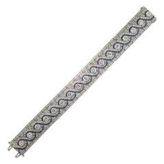 Wide Art Deco Platinum Diamond and Calibre Sapphire Bracelet