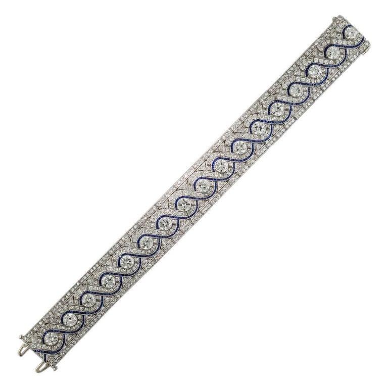 Wide Art Deco Platinum Diamond and Calibre Sapphire Bracelet For Sale