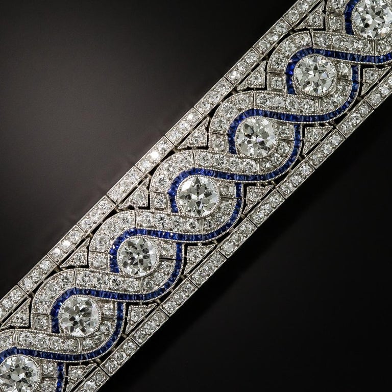 This resplendent Art Deco masterpiece sparkles spectacularly from end-to-end with 17 icy-white, high-quality transitional European-cut/round brilliant-cut diamonds totaling 10 carats. The scintillating stones are enveloped in swirling diamond-set