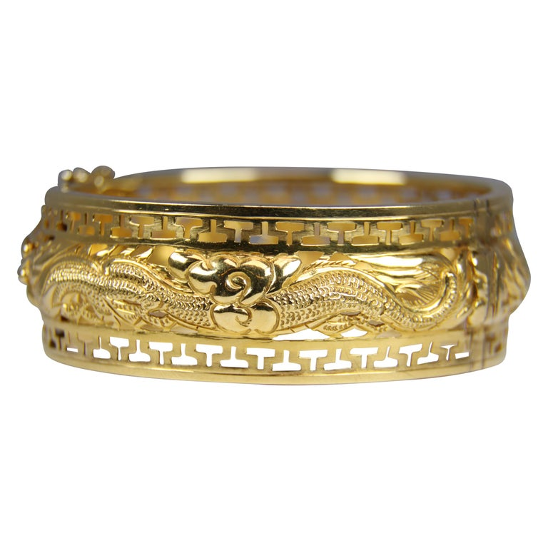 Vintage Wide Bangle Bracelet 7 38 Inches circumference 2 18 diameter 1 14 wide Raised Gold Tone Design