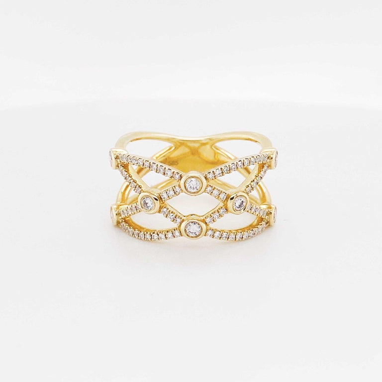 This weaved diamond band is exciting and trendy!  Encrusted with over 75 diamonds this band really sparkles and shines!  The bright 14 karat yellow gold and the beautifully cut diamonds make for a great presentation and can look great on any