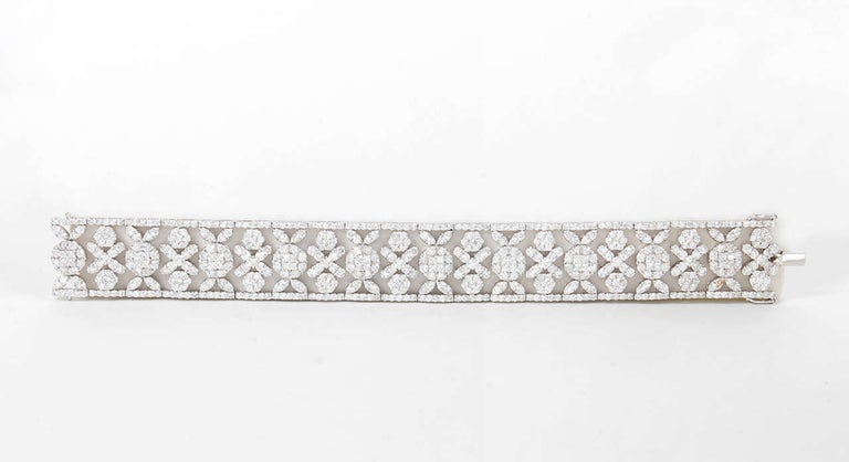 Classic Wreathe Style Wide Diamond Bracelet   20.03 carats of round brilliant cut diamonds set in an exquisite timeless design.  Set in 18k white gold  Approx 3/4 of an inch in width