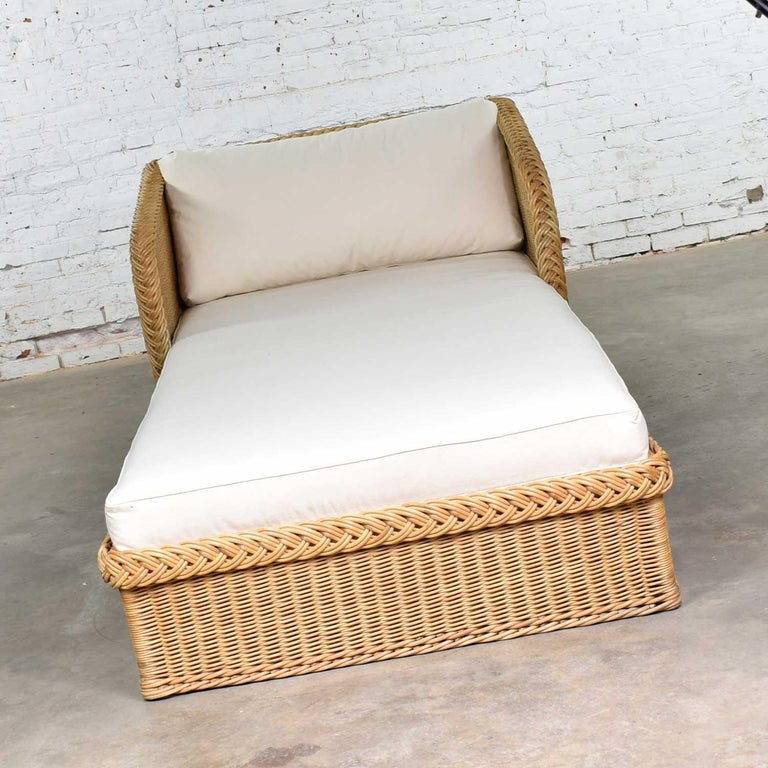 Handsome extra wide wicker chaise W7800 by Bielecky Brothers, Inc. It is in fabulous vintage condition. We have had it recovered in a wonderful white canvas. Please see photos. Circa late 20th century to early 21st century.