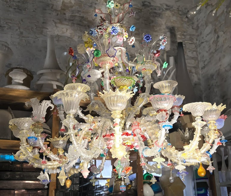 Surprising Rezzonico chandelier made of an infinitive number of glass, each element is different from the other. I made a video for whoever is interested in seeing the complexity of this intriguing chandelier. It's a triumph of flowers, ducks, fish,