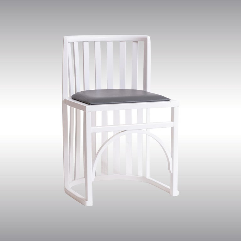 Beechwood white lacquered, seat newly upholstered with gray leather, restored, seems to be the predecessor model of the rare 797 chair by Thonet, compare with the prescription by the Dorotheum Auction House at the Gallery.
