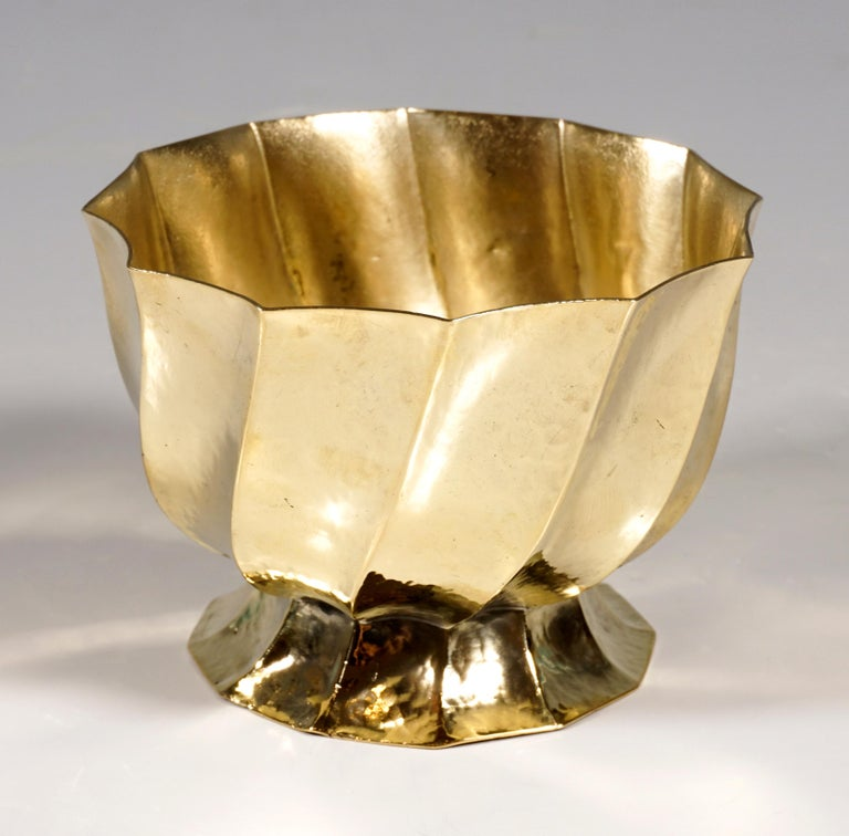 Small cup made of embossed and folded brass with a light hammered decoration. Design of this cigarette holder as part of a smoking set, consisting of serving plate, ashtray, cigarette and cigar holder by Josef Hoffmann, circa 1920.