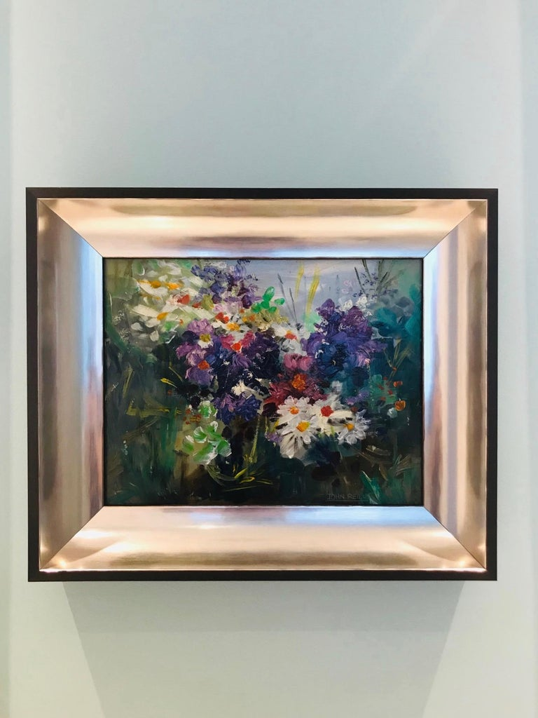 Outstanding contemporary impressionist still life painting depicting a series of wildflowers. Oil on board in custom shadow box frame with ebonized wood exterior and molded interior in satin white gold. Signed on lower right corner by American