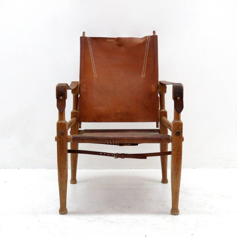 wonderful safari chair, designed by Wilhelm Kienzle in 1928 for Wohnbedarf and manufactured in the early 1950s in Switzerland, with frame made of solid beech, covering in original brown leather, adjustable backrest, can be completely disassembled.