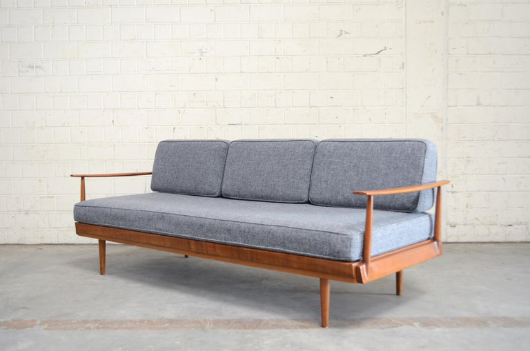 Wilhelm Knoll manufactures this daybed sofa.  From the Series Antimott. Frame is made of lacquered cherrywood. It has a convertible backrest. Fabric was renewed some years ago with grey Kvadrat Halingdal.