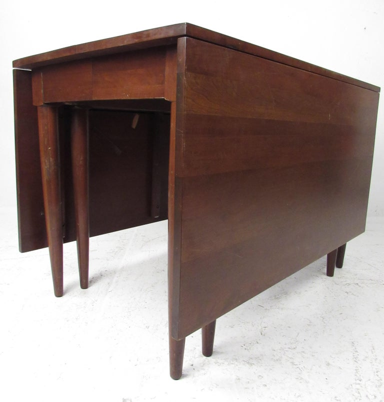 Beautiful, well-made, solid cherry dining table with one leaf made by Consider H. Willett, Inc., Louisville, Kentucky, circa 1960. Please confirm item location (NY or NJ) with dealer.  Measures: Table closed 72