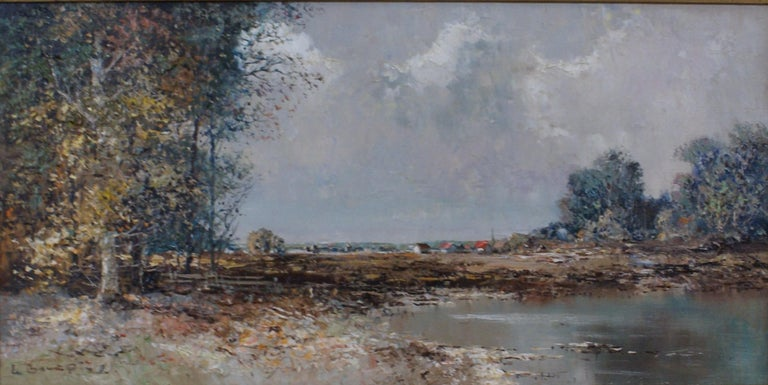 Landscape of an autumnal day; trees and lake in the foreground and village town in the background. Oil on canvas measures 12 x 24; frame dimensions measure 19 1/4 x 31 1/4 x 1 3/4. Artist;s signature, lower left. Housed in a carved wood frame with