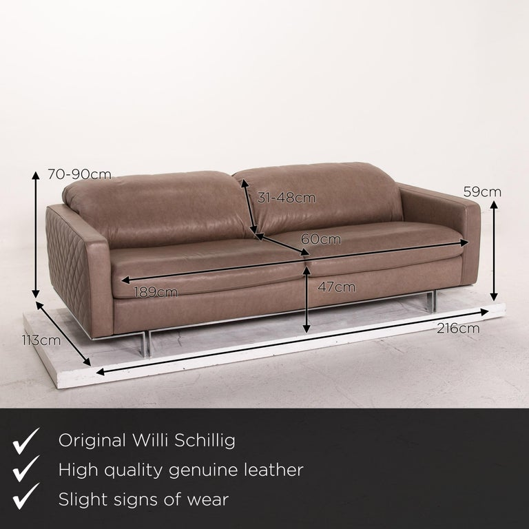 We present to you a Willi Schillig leather sofa gray beige three-seat couch.  Product measurements in centimeters:  Depth 113 Width 216 Height 70 Seat height 47 Rest height 59 Seat depth 60 Seat width 189 Back height 31.