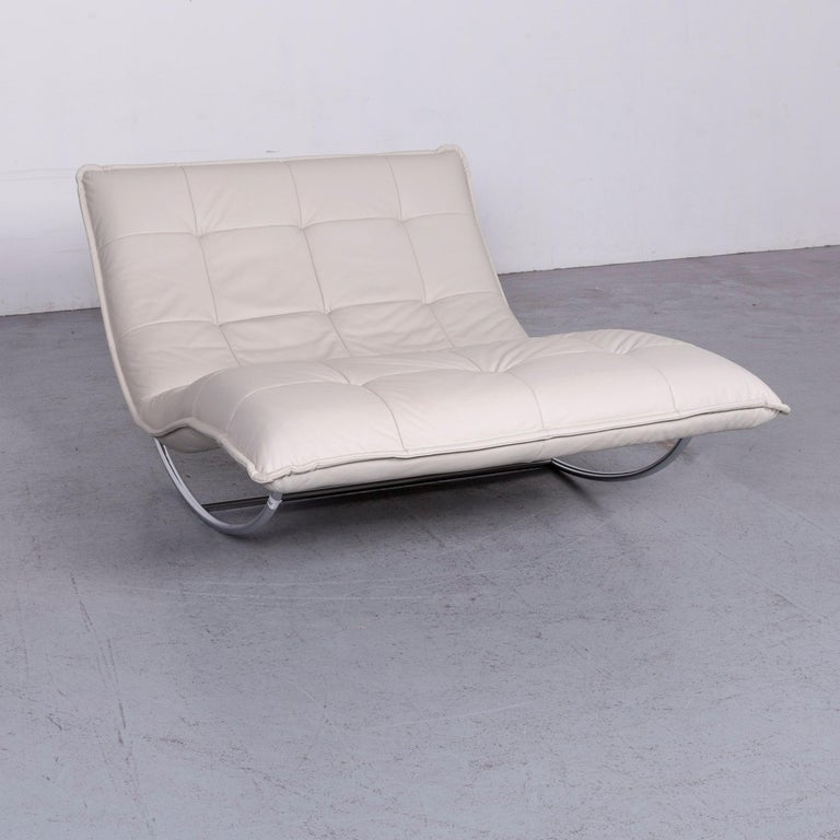 We bring to you a Willi Schillig Woow designer leather couch in crème.