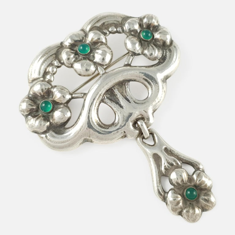 An antique Danish Skønvirke silver & green cabochon cut chrysoprase brooch by William Fuglede - circa 1915. The brooch is stamped with the makers mark 'WmF', & '830'. William Fuglede was a well known maker of Skønvirke (Danish Arts & Crafts