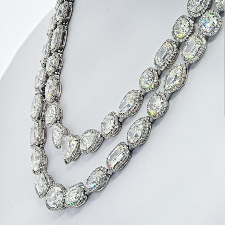 A beautiful example of how fancy shapes can really create a statement piece of jewelry is this diamond necklace by William Goldberg. Designed as a two-row swag of Ashoka [brand name for a round-cornered rectangular modified-brilliant cut], cushion,