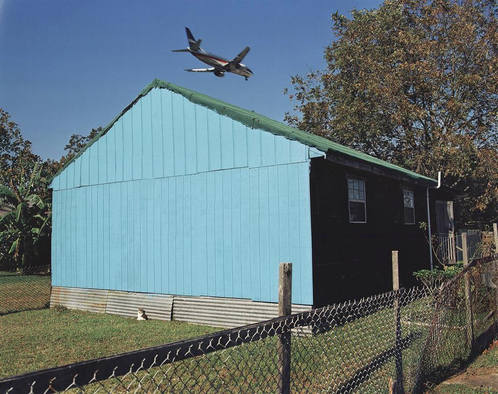 Jet Over Blue & Black House