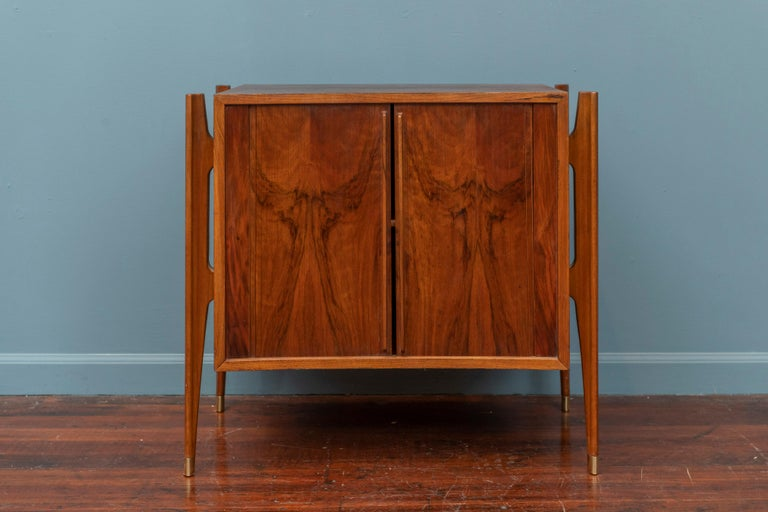William Hinn Exoskeleton small side table or cabinet for Urban Furniture of Sweden in striking walnut with tambor doors and brass capped legs.