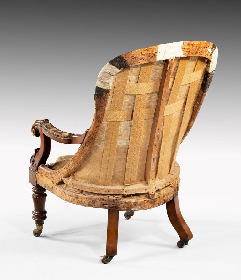 A William IV library chair on scrolled supports over finely turned front legs. Excellent overall condition.