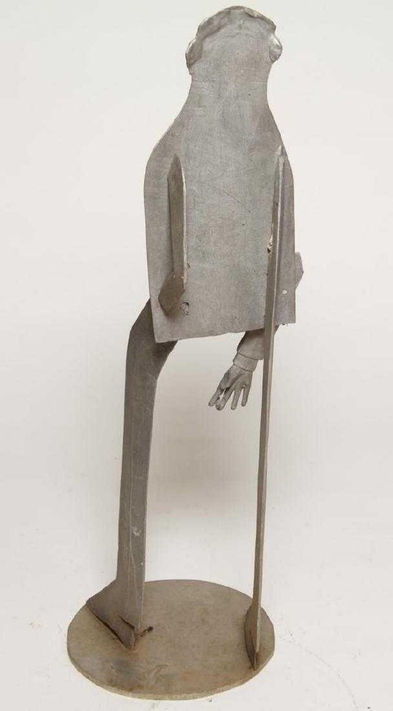 Mid-Century Modern cut steel sculpture depicting a man in bell bottom pants standing casually with a cigarette in his right hand, His left hand is in his back pocket, signed and dated, artist's monogram  and cipher and