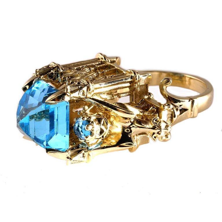 The Alchemist Ring is a wondrous one of a kind piece and fits a size 12 1/4 (Australian & British size Y 1/2).  Handcrafted in 9ct yellow gold this glorious ring features a central 15mm, square topaz, get atop a signature William Llewellyn Griffiths