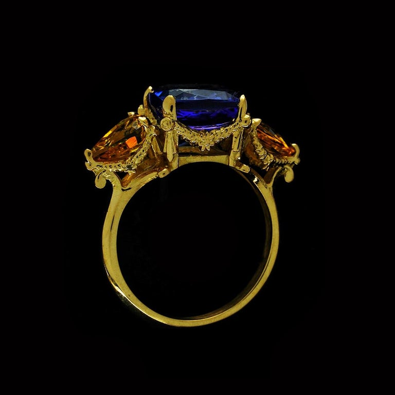 The Tanzanite and Yellow sapphire ring is a breathtaking, one of a kind piece and fits a size 7 3/4 (Australian & British size P 1/2).  Handcrafted in 18ct yellow gold, this divine ring features a central faceted 4.1 carat tanzanite, an