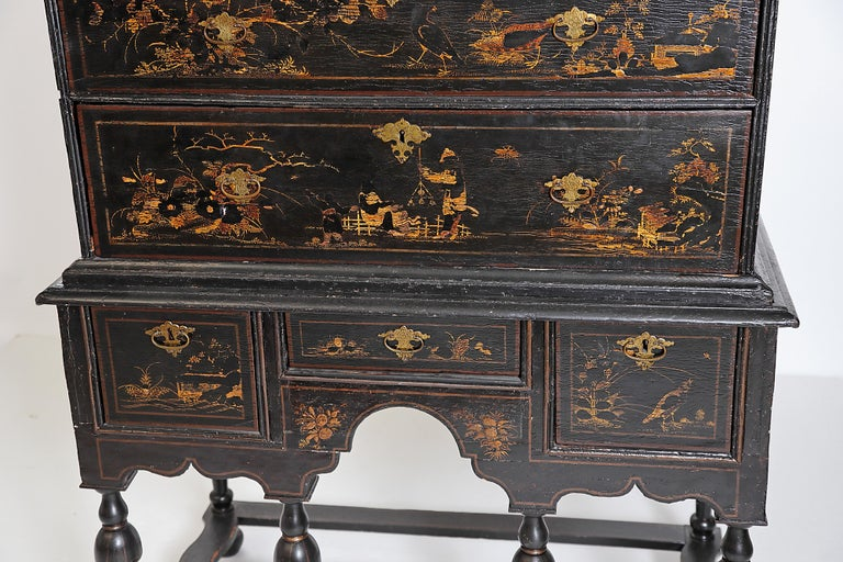 Late 17th-early 18th century William and Mary chest on stand with gilt chinoiserie decoration, Japanned, raised gilt decoration missing and worn in places, especially heads and bodies of people, flowers and leaves, and birds (see attached images),