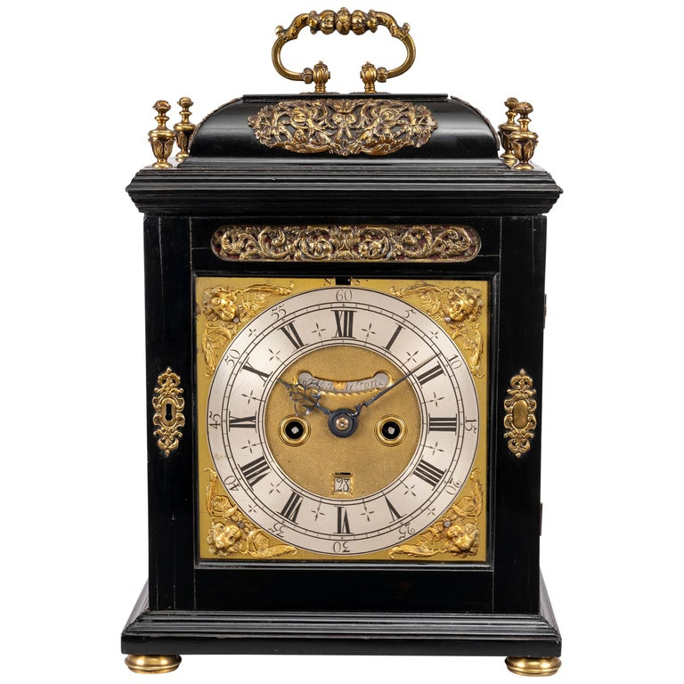 William & Mary ebony and gilt brass table clock by John Shelton, London