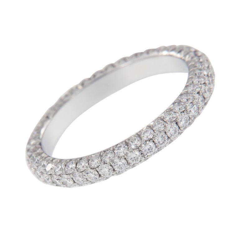 Expertly crafted eternity band by William Rosenberg made from noble platinum with 3 row pave' set round brilliant diamonds = 1.49 Cttw. These exceptional diamonds are of VS clarity & D-F color. This ring was made in a size 6 but can be custom made