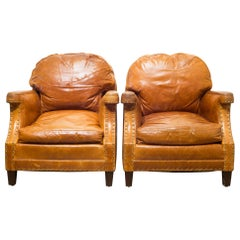 Pair of William-Sonoma Riveted Leather Club Chairs, circa 2007